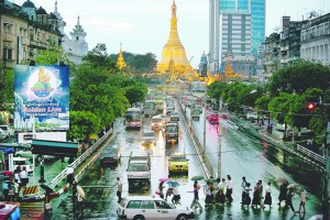Traffic moves along a busy downtown street in Yangon