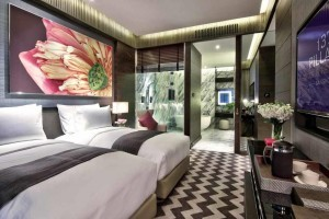 The bedroom of a suite at 137 Pillars Suites & Residences Bangkok