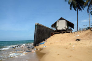 The only thing between this house in Pattani province and the strong waves is a seawall.