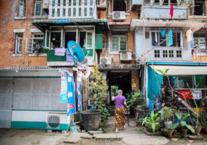 A resident walks into Yangon's Min Ma Naing government housing project